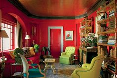 In the library of  Elizabeth and W. Clarke Swanson's San Francisco apartment, designer Thomas Britt marbleized a door frame and the baseboards; the curtains are made of a Scalamandré stripe | archdigest.com