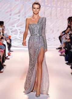 ZUHAIR MURAD - Art Deco-inspired beaded one shoulder gown with square neckline and high slit in sliver.