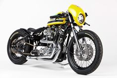 The DP Customs Defensor Harley ironhead is an unlikely tribute to one of the greatest Formula 1 drivers of all time. Can you guess which one? Click the pin for more! Custom Bobber, Custom Harleys, Custom Bikes, Harley Bobber, Bobber Chopper, Harley Davidson Chopper, Harley Davidson Sportster, Women Motorcycle Quotes, Safari