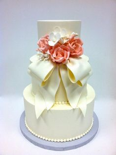 modeling chocolate flowers | ... Buttercream exterior, modeling chocolate bow, handmade sugar flowers