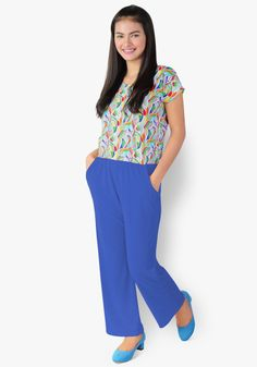 A chic and classy look? It's all in this print and plain jumpsuit. Spandex fabric, gartered waist with side pockets. So stylish you'd want to hop all around the town! How To Look Classy, Spandex Fabric, Garter, Royal Blue, Jumpsuits, Capri Pants, Pockets, Chic, Stylish