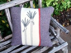 This is an original hand embroidered cushion made from 100% wool upcycled grey and cream blankets..The back is all grey and is also wool. There is a zip closure in the back.  The cushion measures 45 cm x 45 cm.   Hand wash only.   This cushion does not include an inner.