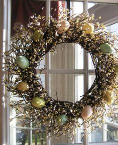 An artfully arranged collection of soft pastel-coloured eggs, berries and rattan grapevines hanging on a wall or your front door is an elegant Easter decor idea that'll provide a wonderful welcome for guests.