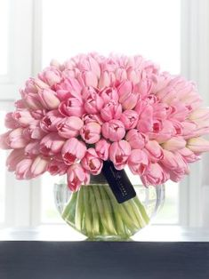 Gorgeous display of pink tulips in vase
