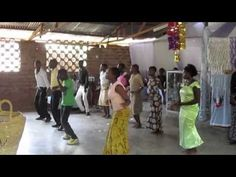 Need a shot of joy?  Carly Crookston, World Racer, crafted this fun & be-a-u-ti-ful video of the dancing church services she joined in Africa. (carlycrookston.th...)