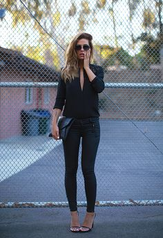 Jennifer Grace is wearing all black sunglasses from Chanel, see through trim top from The Kooples, clutch from Givenchy, jeans from Rag & Bone and the sandals are Saint Laurent