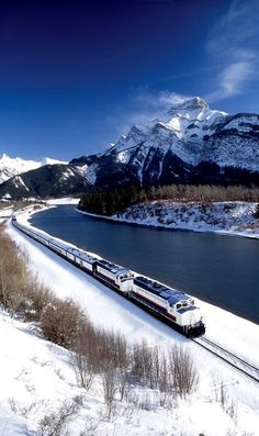 "The ""Rocky Mountaineer Train"" on the Canadian Pacific Railway through Banff National Park."