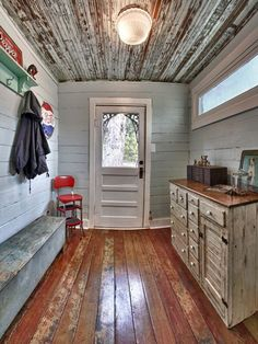 Mudroom - it's a new addition with old salvaged finds to give it a vintage look