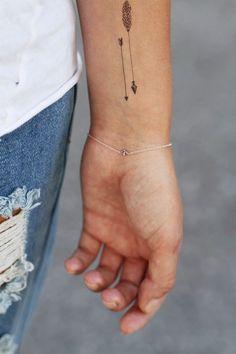I love really subtle, simple tattoos. #arrow