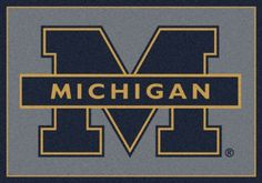 "Michigan Wolverines 5' 4"" x 7' 8"" Team Spirit Area Rug"