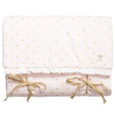 Baby girls pink and gold polka dotted changing mat by Carrément Beau. Made with smooth cotton, with light padding and a soft terry towelling on the other side. It can be simply folded up and tied with the sparkly gold ribbons for easy storage and can be machine washed. Measurements: Length 66cm x Width 46cm (26
