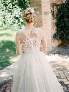 tulle wedding gown with long lace sleeves
