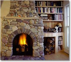 The stone fireplace hearth . few things are as warm and inviting as a crackling wood fire in a cozy stone fireplace! River Rock Fireplaces, Stacked Stone Fireplaces, Fireplace Hearth, Home Fireplace, Fireplace Ideas, Fireplace Stone, Fireplace Shelves, Fireplace Makeovers, Fireplace Kitchen