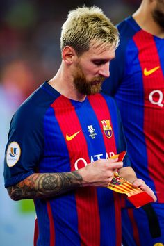 Lionel Messi of FC Barcelona looks the captain armband after the Spanish Super Cup Final second leg match between FC Barcelona and Sevilla FC at Camp Nou on August 17, 2016 in Barcelona, Catalonia.
