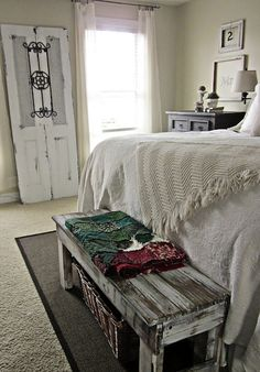 Bench at the end of the bed with baskets under it.  And, in that tiny little distressed frame there is just a number.  Use other items in other frames too, not together but in different places.