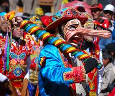 The large nose signifies authority and power.  Cuzco Days parade, Peru