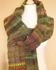 Hand woven scarf featuring hand spun yarn. Saori scarf.