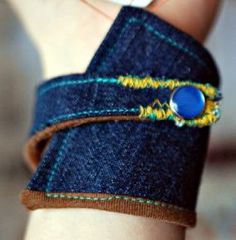 How to Make a Recycled Fabric Cuff 2019 Two contrasting thread colors add interest. The post How to Make a Recycled Fabric Cuff 2019 appeared first on Denim Diy. Denim Bracelet, Fabric Bracelets, Cuff Bracelets, Jeans Denim, Old Jeans, Textile Jewelry, Fabric Jewelry, Jewellery, Collar Diy