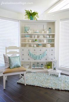 Spring Summer Home Decorating in Aqua & White. The sequin pillow, which reminds me of a Mermaids tail.. the go-with-everything whiteware and the candle lantern are some of my favorite HomeGoods home decorating finds. I love how they make the space feel fresh & airy!!