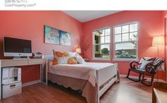 Such a warm beachy bedroom.  The walls have all the color and all the furniture is in muted colors.