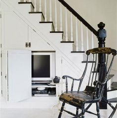 A Shelter Island fisherman's cottage - beach-style - Staircase - New York - SchappacherWhite Architecture D. Cabinet Under Stairs, Space Under Stairs, Fishermans Cottage, Traditional Staircase, Black And White Interior, Black White, Black Trim, White Wood, Shelter Island