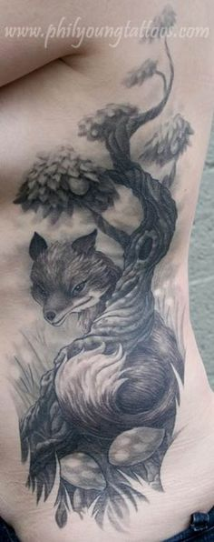 Phil Young fox tatt love the sly look on his face and the way the tree appears to be an extension of his tail
