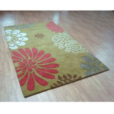 @Overstock - This wool rug is made with hand-tufted custom dyed yarns for plushness. Luxurious and unique, it will accentuate any room in your home with its appealing colors and fashionable design.http://www.overstock.com/Home-Garden/Hand-tufted-Giant-Flowers-Green-Wool-Rug-8-x-10/4806484/product.html?CID=214117 $314.99