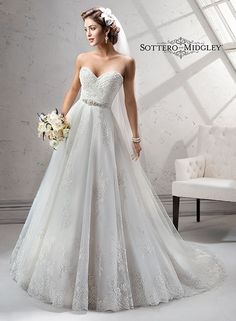 Traditional romance is found in this stunning ballgown wedding dress, Noreen by Sottero and Midgley. Complete with romantic sweetheart neckline and glimmering metallic accents.