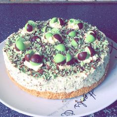 Mint aero cheesecake**  **Base** 15 digestive biscuits 250g butter  **filling** 320g plain Philadelphia 250g icing sugar 250ml whipping cream 2 grated large mint aero bars Bag of aero bubbles (to decorate)