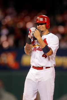 Yadier Molina smiles towards the dugout after hitting an RBI double against the Colorado Rockies... eighth inning. Cards won 5-1. 9-12-14