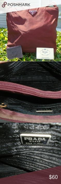 "Prada maroon Nylon tote shoulder bag w/ card. Prada maroon tote shoulder bag w/ card. Bag uS silver logo on front. Black signatiure 'Prada' lining. It has dirt scuffs wear.  L 13"" W 3"" H 10"" Handle drop 8"" Prada Bags Totes"