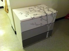 My first Pinterest original! DIY Ikea MALM dresser!   It was SO easy to do...  Primed with Zinsser BIN Primer then used CIL tester paints from the same swatch family.  Sketched the tree from an image of a decal and then painted!