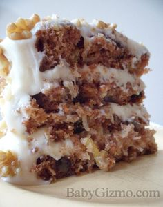 My husband would never eat this but it looks and sounds so good! Best Carrot Cake Ever! Filled with carrots, raisins, pineapple, coconut, and nuts. Drizzled with a buttermilk glaze and then iced with cream cheese frosting. Cupcakes, Cupcake Cakes, Poke Cakes, Layer Cakes, Just Desserts, Delicious Desserts, Yummy Treats, Sweet Treats, Cake Candy