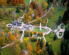 An aerial view of Linderhof Castle highlights its ornate landscape, Bavaria, Germany. Linderhof Palace, Bavaria Germany, Aerial View, Austria, Golf Courses, Arch, Nature, Landscape, World