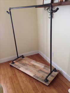 Pipe clothing rack with reclaimed pallet base on wheels BUILTbyTOUCH.com