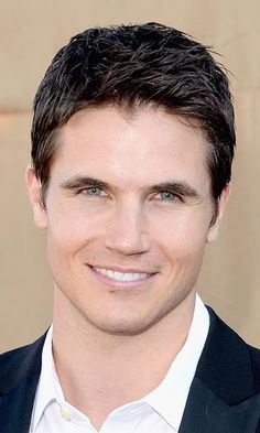 """ROBBIE AMELL, 26: The 'Tomorrow People' actor from Toronto loves """"staying in and taking it easy with my girlfriend,"""" fellow Canadian actress Italia Ricci. Photo: © Getty Images"""
