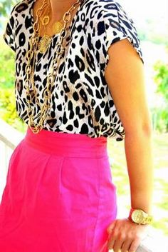 hot pink, animal print and lots of gold necklaces
