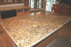 Instant Granite Countertop Venetian Gold. Sticks on countertop like contact paper, can be peeled off when you move out