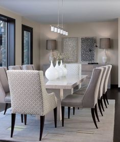 Contemporary Dining Room with INSPIRE Q Jourdan Grey Link Sloped Arm Hostess Chair, Concrete floors, Pendant Light