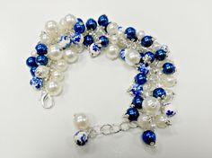 Mira este artículo en mi tienda de Etsy: https://www.etsy.com/es/listing/483095785/pulsera-de-perlas-blancas-y-azules