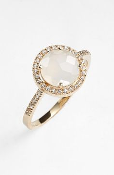 Free shipping and returns on KALAN by Suzanne Kalan Round Sapphire Bezel Ring at Nordstrom.com. A sparkling semiprecious stone nests within a shimmering bezel of pavé sapphires in a sweet and feminine ring.
