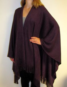 Shawls are my favorite for fall but I must have a purple ruana cape wrap for its full wide coverage. Can't live without the ease and comfort of a full ruana wrap.
