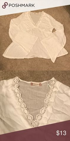 Altar'd State Top✨ New. Never worn. Ivory with crochet down the necklace & bell bottom sleeves! It fits more of a medium or someone who doesn't have broad shoulders! Any questions just ask! Altar'd State Tops Blouses