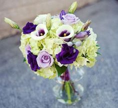 #bouquet featuring green hydrangeas, purple lisianthus, lavender roses and Picasso calla lilies