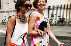 freelance writer Miroslava Duma (left) and designer friend Vika Gazinskaya, arm in arm, in between haute couture show