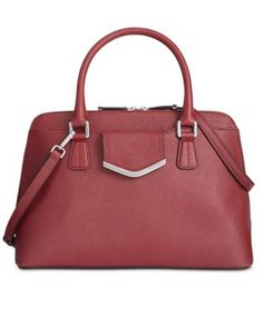 Calvin Klein On My Corner Saffiano Satchel $128.25 Give your look polished perfection with this refined satchel from Calvin Klein. Crafted in sumptuous Saffiano leather with discrete signature detailing, it's destined to carry you from desk-to-dinner and anywhere in between.