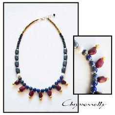 - Chryssomally elegant statement necklace with blue lapis, burgundy howlite, yellow and white pearls, grey hematite, black lava and gold crystals. Gemstone Necklace, Beaded Necklace, Fashion Art, Fashion Design, Pearl White, Burgundy, Delicate, Etsy Shop, Gemstones