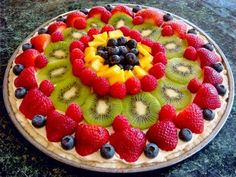 We made a dessert pizza like this using cookie dough for a crust, a whipped frosting-like topping, and covered it with fruit. Dessert Pizza, Fruit Dessert, Delicious Desserts, Dessert Recipes, Yummy Food, Pizza Recipes, Cooking Recipes, Cooking Game, Fruit Tart