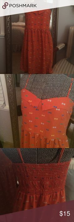 Francesca's Paisley and Ivy summer dress size M Adorable burnt orange dress with bow detail. Adjustable straps size Medium. Purchased from Francesca's and is in great condition! Paisley and Ivy Dresses Mini
