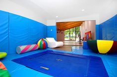 Children's playroom!! some people just want a room with a nice carpet that won't stain...I want a trampoline and foam crap!